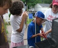 Photo of students grilling with instructor.