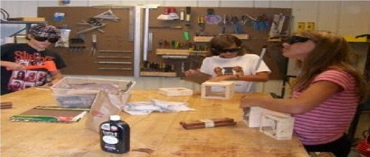 Photo of students working in industrial arts.