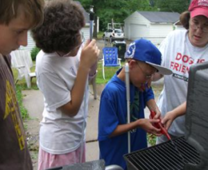 Buddy students learn to light the grill.